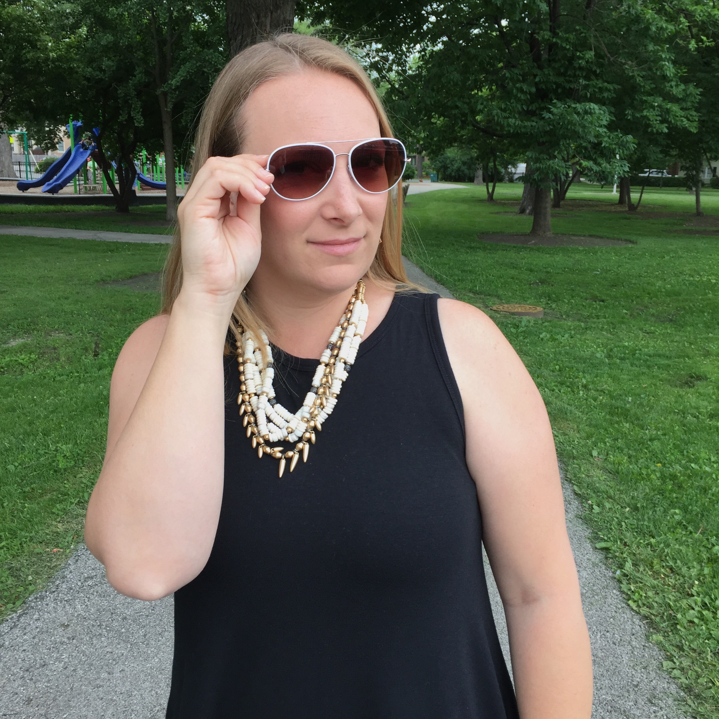 fashion blogger wearing stella dot aviator sunglasses, nomad statement necklace, black old navy swing dress